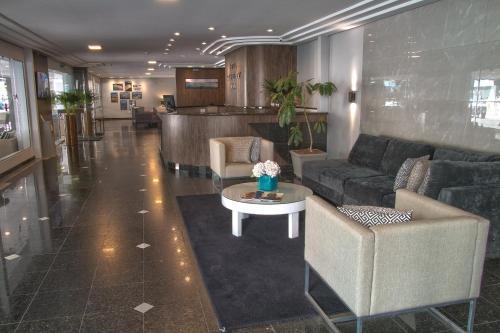 The lobby or reception area at Hotel Gracher Praia
