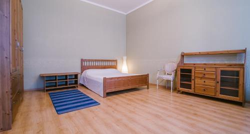 Кровать или кровати в номере RentPiter Pushkinskaya 14 big apart