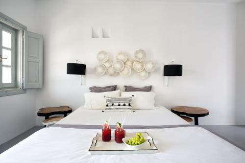 A bed or beds in a room at Blue Sand Boutique Hotel & Suites