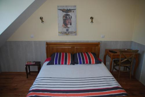A bed or beds in a room at Hotel Des Bains