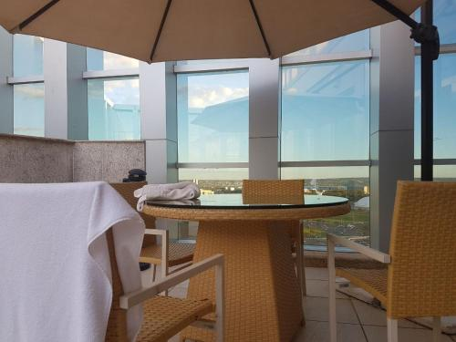 A restaurant or other place to eat at Flat Vision Hoteleiro Norte