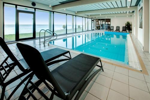 The swimming pool at or near Helnan Marselis Hotel