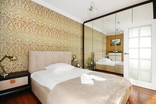 Łóżko lub łóżka w pokoju w obiekcie Livin Premium Apartments