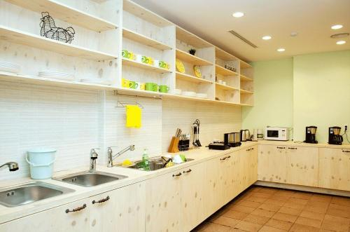 A kitchen or kitchenette at You&I Guesthouse