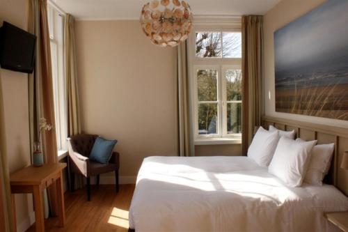Een bed of bedden in een kamer bij Loetje Overveen
