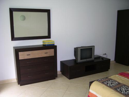 Телевизор и/или развлекательный центр в Балтийский Бриз наем жилых комнат у моря