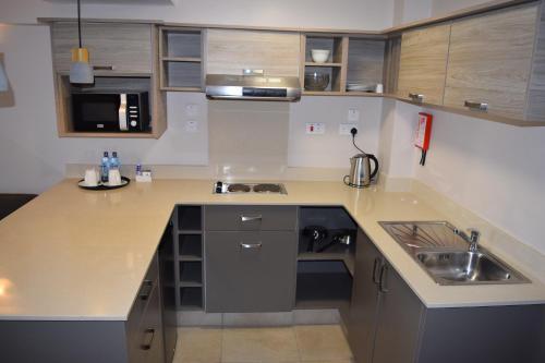 A kitchen or kitchenette at Hillpark Hotel