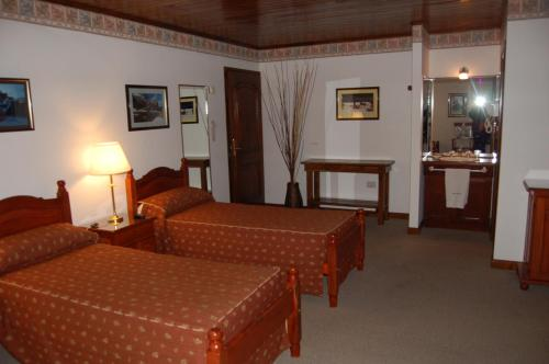 A bed or beds in a room at Posada Fueguina