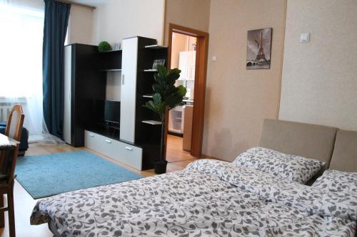 Кровать или кровати в номере Квартира на Морском