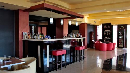 The lounge or bar area at Hotel Angellis