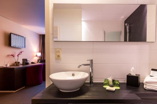Salle de bains dans l'établissement Hotel Royal