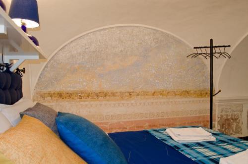 Letto o letti in una camera di Antico Monastero Di Anacapri