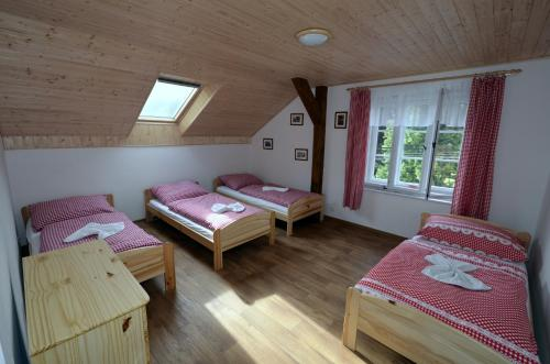A bed or beds in a room at Hospoda U Lipy