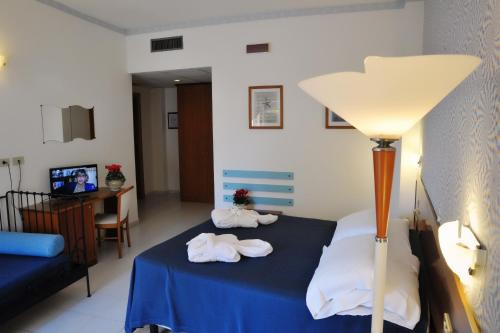 A bed or beds in a room at Villa Dei Principi Hotel