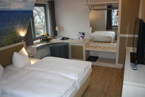 Ein Bett oder Betten in einem Zimmer der Unterkunft Hotel Haus am Meer