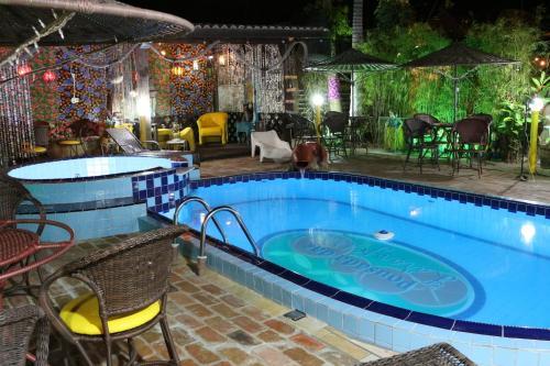 The swimming pool at or near Pousada das Laranjeiras