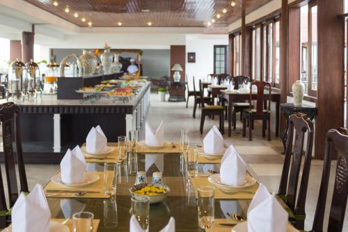 A restaurant or other place to eat at Acacia Heritage Hotel