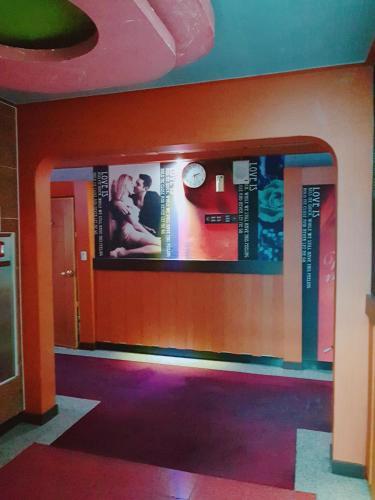 El vestíbulo o zona de recepción de Win Motel