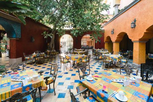 Restaurant ou autre lieu de restauration dans l'établissement Europe Villa Cortes GL