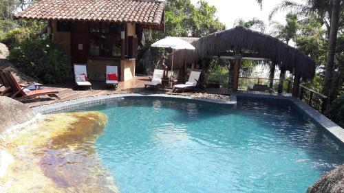 The swimming pool at or near Pousada Refugio das Pedras