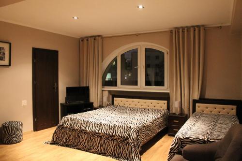 Łóżko lub łóżka w pokoju w obiekcie Villa Lido