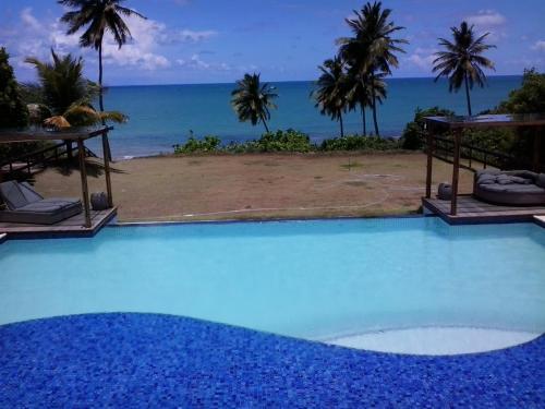 The swimming pool at or near Brisa de Carapibus