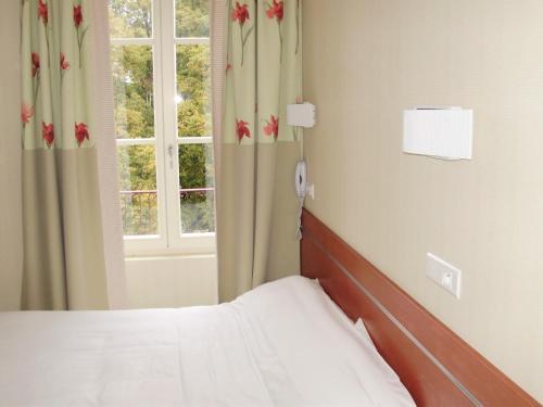 Un ou plusieurs lits dans un hébergement de l'établissement Hotels & Résidences - Les Thermes