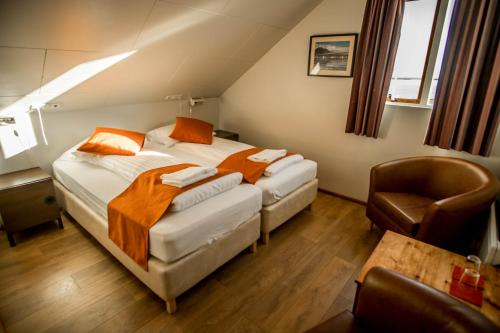 A bed or beds in a room at Gerdi Guesthouse