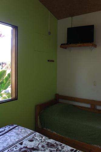 A television and/or entertainment centre at Pousada O Canto das Sereias