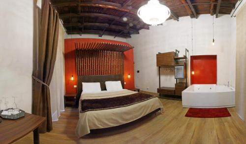 A bed or beds in a room at Duomo Luxury Suites