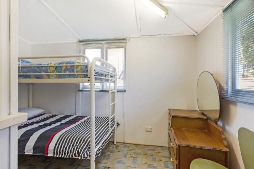 A bunk bed or bunk beds in a room at Pet Friendly Beach Cottage @ Ballingalla
