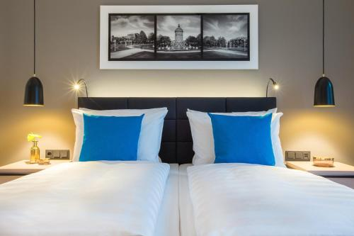 A bed or beds in a room at Radisson Blu Hotel, Mannheim