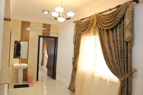 Um banheiro em Mozn Abha Furnished Units