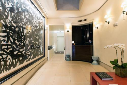 The lobby or reception area at City Club Hotel