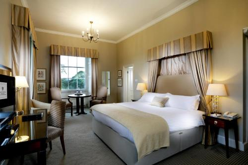 A bed or beds in a room at Macdonald Linden Hall, Golf & Country Club