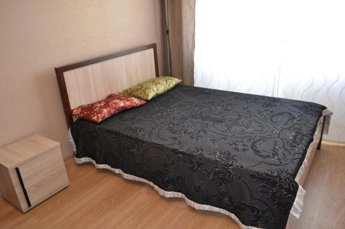 Кровать или кровати в номере Революции 1905 Года 31в
