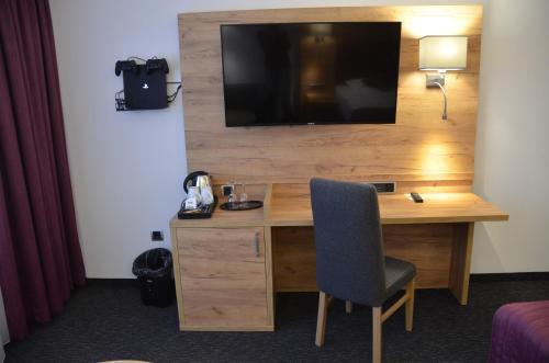 Телевизор и/или развлекательный центр в Hotel Touric