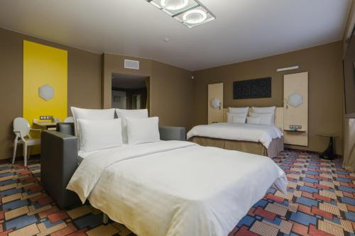 A bed or beds in a room at Dom Hotel NEO