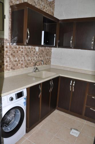 A cozinha ou cozinha compacta de SHALLY RESIDENCE 2