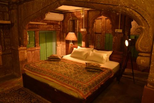 A bed or beds in a room at The Arch Boutique Home stay