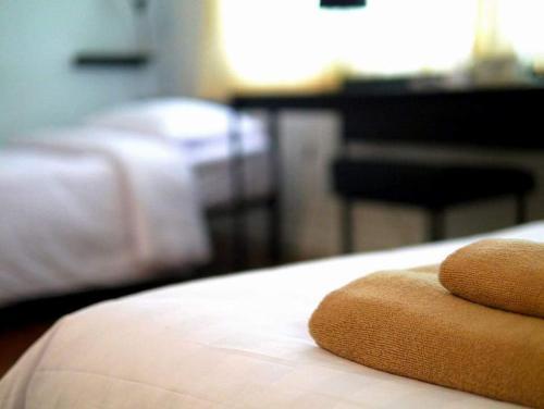 Ein Bett oder Betten in einem Zimmer der Unterkunft G9bangkok