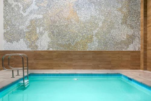 The swimming pool at or near AC Hotel by Marriott San Francisco Airport/Oyster Point Waterfront