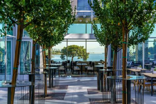 A restaurant or other place to eat at AC Hotel by Marriott San Francisco Airport/Oyster Point Waterfront
