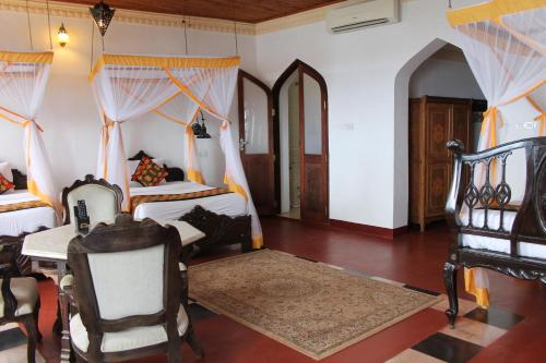 A bed or beds in a room at Mizingani Seafront Hotel