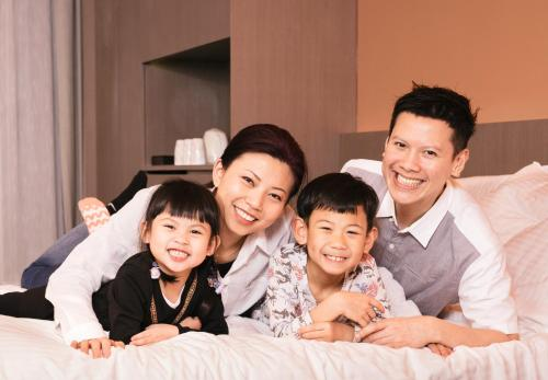 A family staying at Butterfly on Wellington Boutique Hotel Central