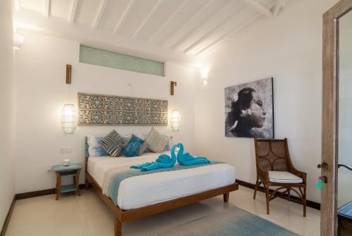 A bed or beds in a room at De'Coco Villa and Suites