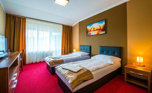 Posteľ alebo postele v izbe v ubytovaní Hotel Glamour