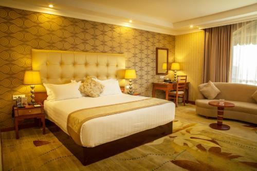 Cama o camas de una habitación en Jupiter International Hotel - Bole
