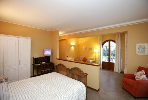 A bed or beds in a room at La Valletta Relais