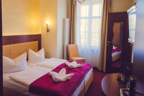 Кровать или кровати в номере Hotel Arena City